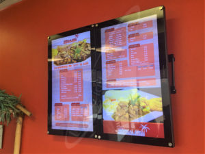 A UTG Wall Mounted LCD Screen at Fishy's Tropical Grill