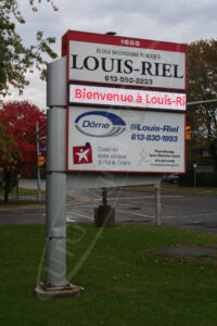 A UTG Outdoor LED Pylon sign at Louis Riel