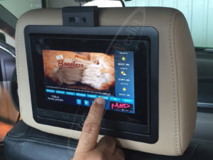 A UTG Head Rest Touch Screen in a Green Taxi Cab