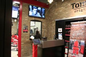 A UTG Wall Mounted LCD Screen at Tommy Gunns Hair Salon